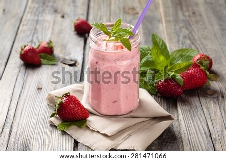 Fruit smoothie with mint leaves on wooden rustic table.  - stock photo