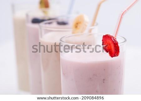 Fruit smoothies with blueberries , strawberry, kiwi and banana - stock photo