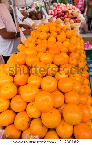 Fruit stall on a pavement of the chinatown road in Bangkok - stock photo