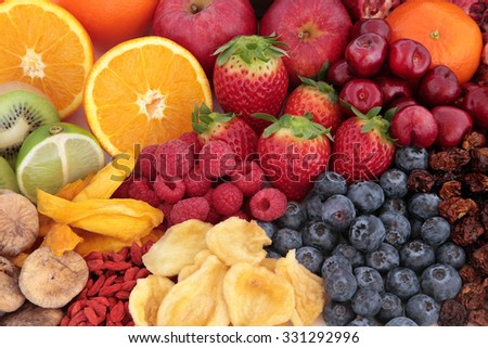 Fruit superfood background with fruits high in antioxidants, vitamin c and dietary fibre.   - stock photo