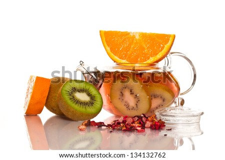 fruit tea in a teapot isolated on white background - stock photo