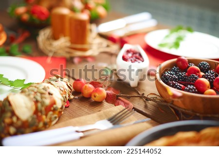 Fruits and berries on served festive table - stock photo