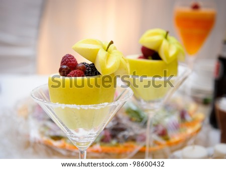 Fruits and berries Wedding table decoration - stock photo