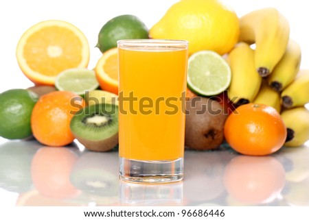 Fruits and glass of fresh juice - stock photo