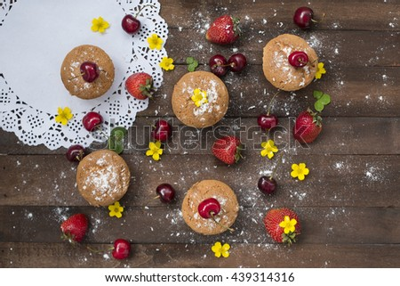fruits and sweet pastries on a rustic background - stock photo