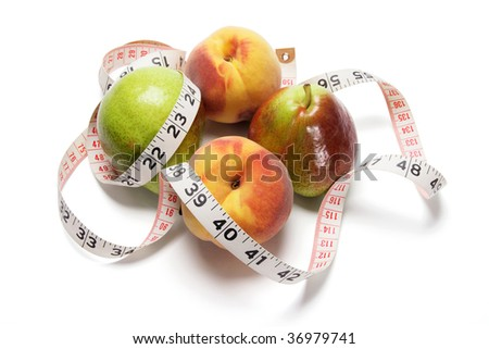 Fruits and Tape Measure on White Background