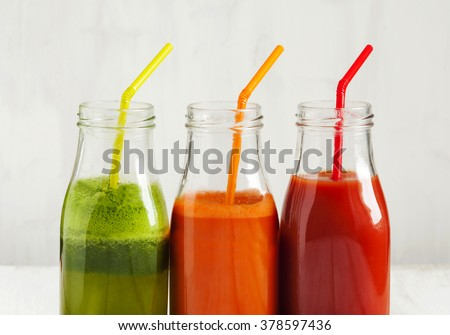 Fruits and vegetable juice in bottle: Apple and spinach juice, Carrot juice and Tomato juice