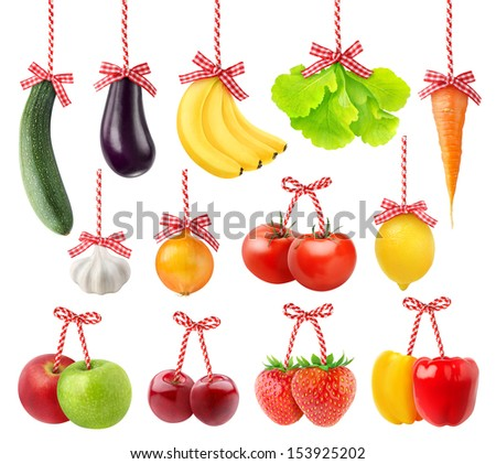 Fruits and vegetables as Christmas decoration isolated on white - stock photo