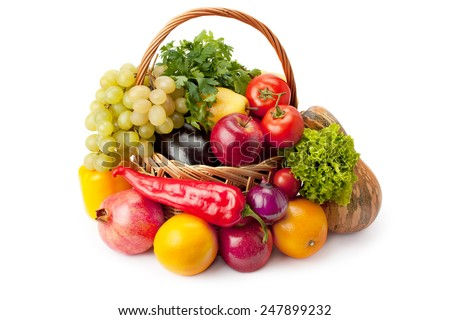 fruits and vegetables in a basket isolated on white background - stock photo