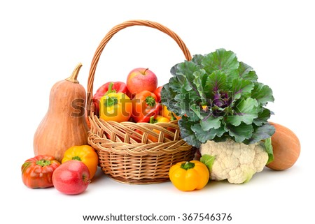 Fruits and vegetables in basket isolated on white - stock photo