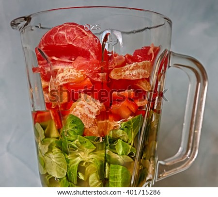 fruits and Vegetables in blender - stock photo