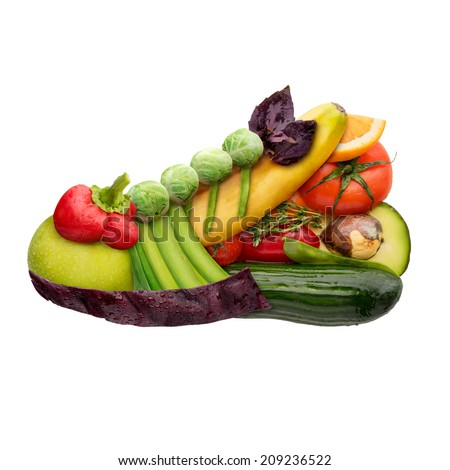 Fruits and vegetables in the shape of a shoe trainer for running, food concept isolated on white background. - stock photo