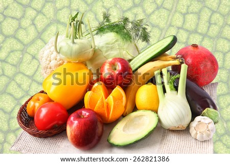 Fruits and vegetables isolated on the green leaf texture background - stock photo
