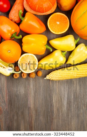 Fruits and vegetables on wooden table - stock photo