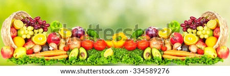 Fruits and vegetables over green background. Healthy diet. - stock photo