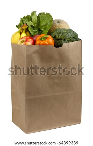 Fruits and vegetables shot in brown paper grocery bag, silhouetted on white background - stock photo