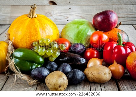 Fruits and vegetables with pumpkins in autumn vintage still life - stock photo