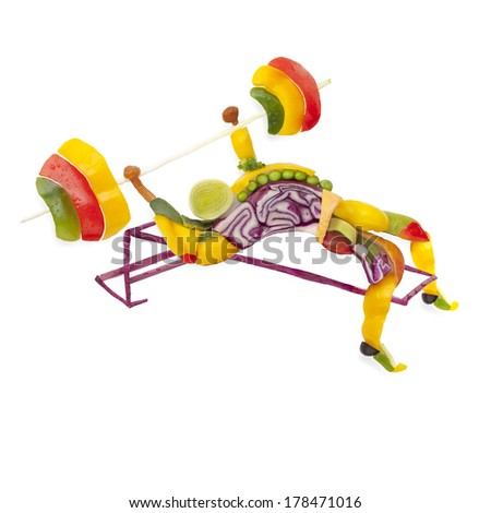 Fruits and vegs in the shape of a healthy muscular bodybuilder lifting a barbell. - stock photo