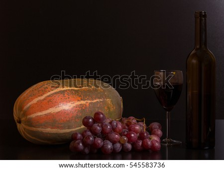fruits and wine on a black background, studio picture