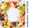 Fruits, berries and flowers frame, white wooden background. Copy space. - stock photo