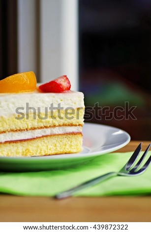 Fruits cream cake. Tasty homemade white yogurt cream cake with mixed fruity. Sponge cake with cream and fresh fruit. Dessert. - stock photo
