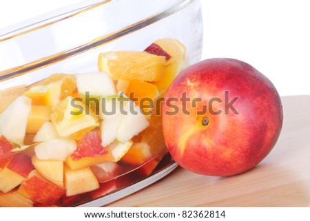 Fruits for sangria in glass bowl, closeup - stock photo