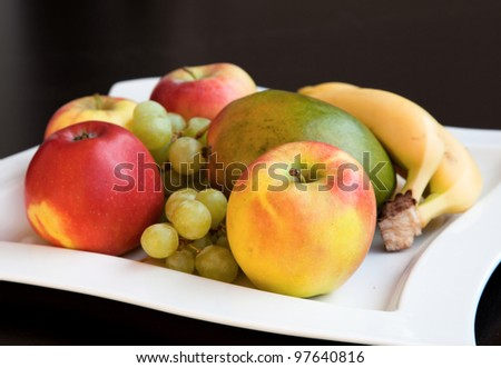 Fruits in a bowl - stock photo