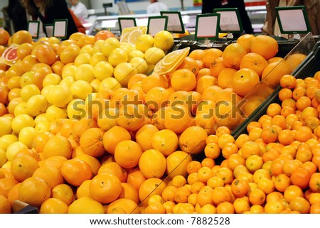 Fruits in a shop with blank board (perfect place to put text on,shallow DOF) - stock photo
