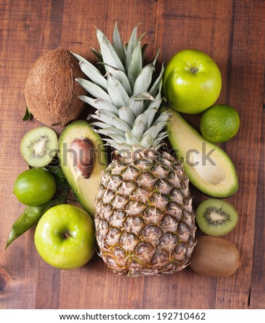 fruits  on background wooden table - stock photo