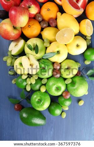 Fruits on dark blue wooden background - stock photo
