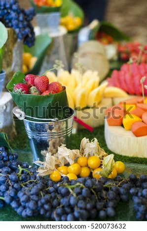 Fruits on green background.