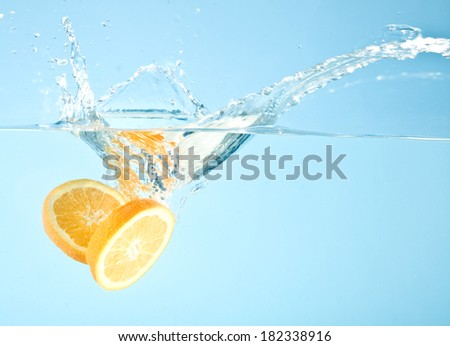 fruits splashed into water