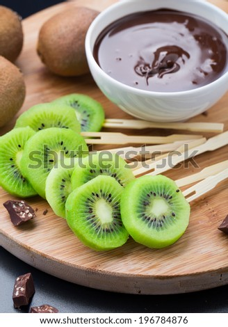 Fruits with chocolate on a stick - stock photo