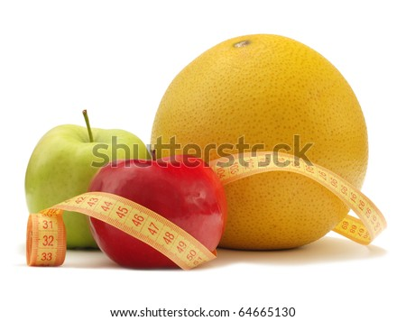 Fruits with measuring instrument on a white background - stock photo