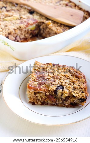 Fruity baked oatmeal in baking tin on table
