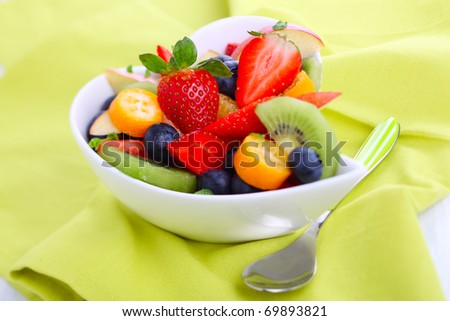 Fruity summer salad in white bowl - stock photo