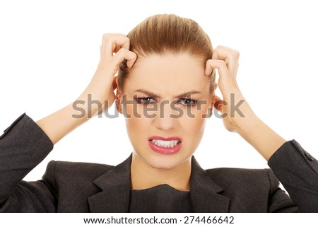Frustrated and angry business woman screaming loud. - stock photo