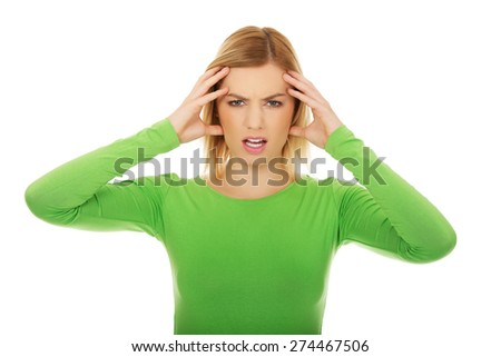 Frustrated and angry woman screaming loud. - stock photo