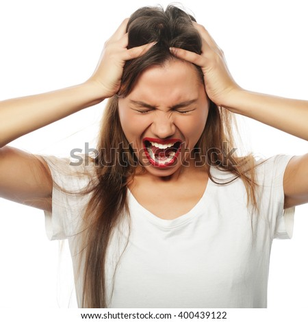 Frustrated and angry woman screaming. Studio shot. - stock photo