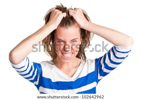 Frustrated and angry woman with hands in her hair pulling - stock photo