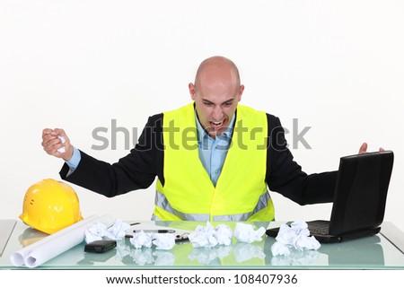 Frustrated architect - stock photo