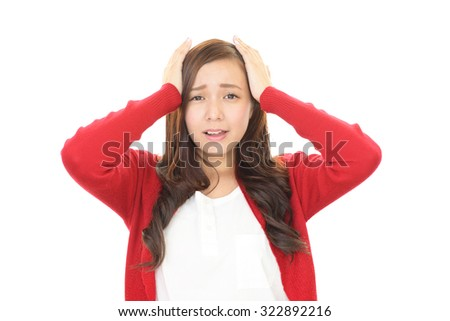 Frustrated Asian woman - stock photo