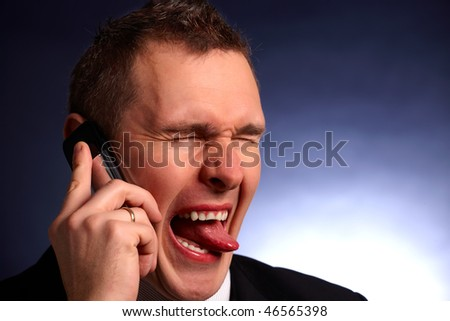 Frustrated business man with mobile phone - stock photo
