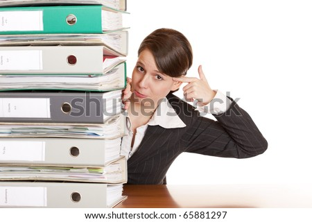 Frustrated business woman behind folder stack gets headshot. Isolated on white background. - stock photo
