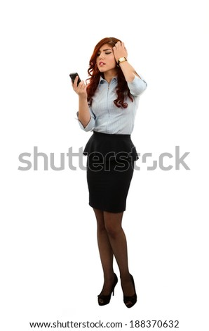 Frustrated business woman pulling her hair and yelling at her phone - stock photo