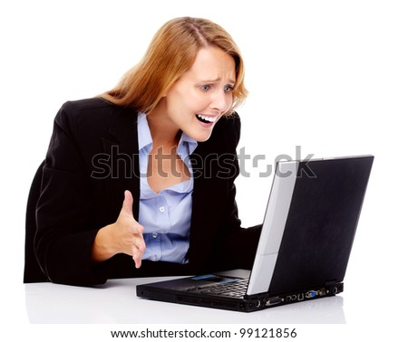 frustrated business woman with stress headache sitting at her desk with computer isolated on white. - stock photo