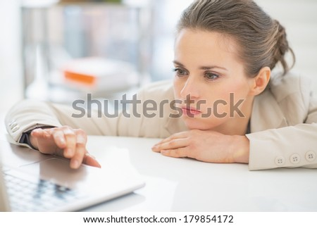 Frustrated business woman working with laptop in office
