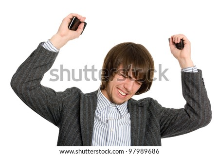 Frustrated businessman holding a mobile in his raised hands. - stock photo