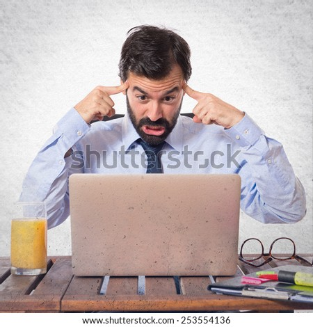 frustrated businessman in his office - stock photo