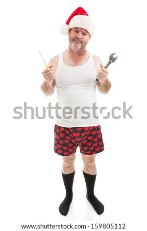 Frustrated dad in a Santa hat holding his tools.  He looks scruffy, like he's been up all night assembling Christmas presents.  Full body isolated on white. - stock photo